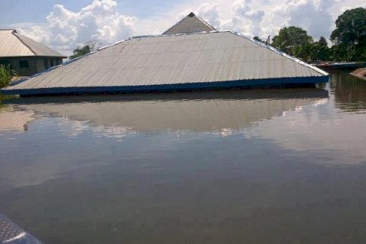 A house submerged in flood at Anam in 2012